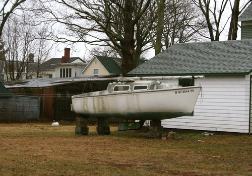 Instead of old Camaro's on cinder blocks, they have old boats (Greenport).